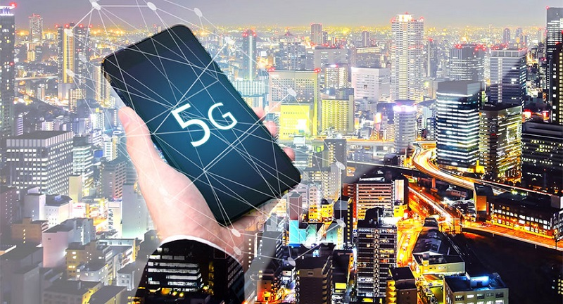 5G network wireless systems digital hologram and internet of things on city background.
