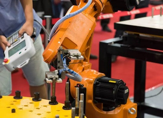 A Senior Technician Operating The Collaborative Robot In Manufacturing Industry.